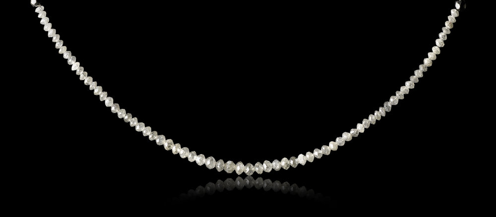 18.25 ct. white faceted diamonds in a collier
