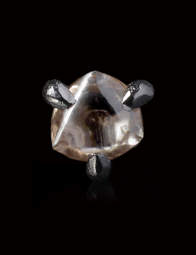0.28 carat Brownish diamond in 14K white gold pin.jpg