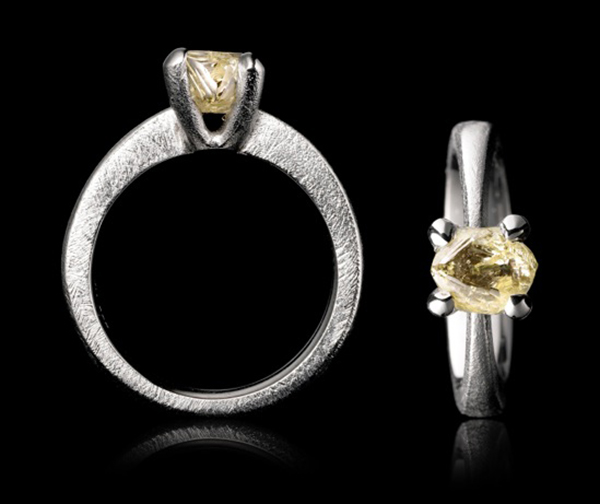 Yellowish+uneven+diamond+hovering+in+a+white+gold+ring..jpeg