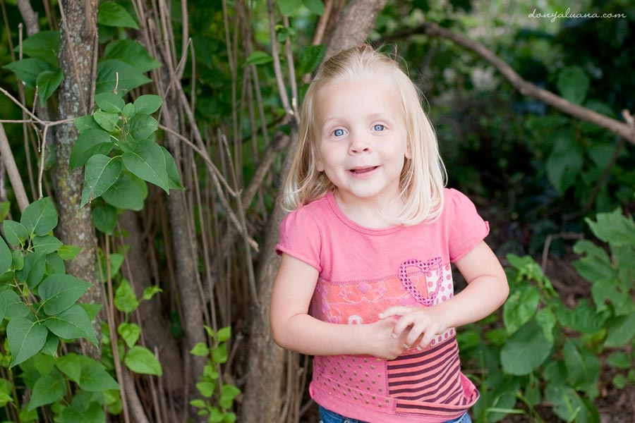 Four year old poses for portraits in Burnsville Backyard