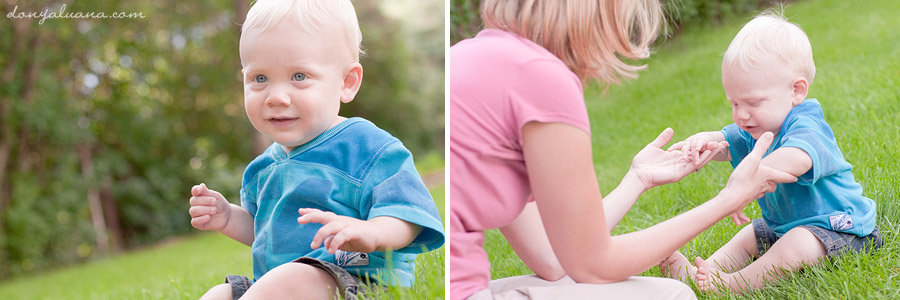 Baby boy attempts to stand in backyard for family portraits