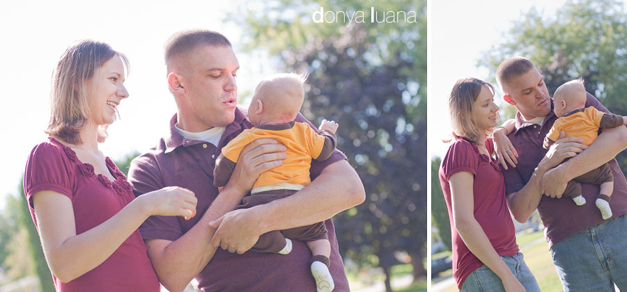 Burnsville Couple pose with their baby boy for portraits in their backyard