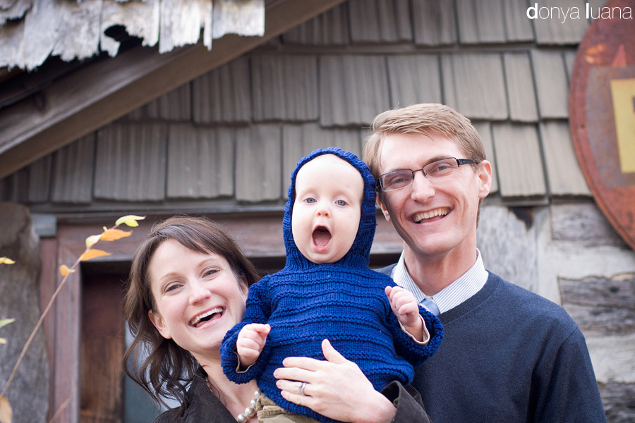 Mom, Dad, and one year old son smile for family portraits in Twin Cities area