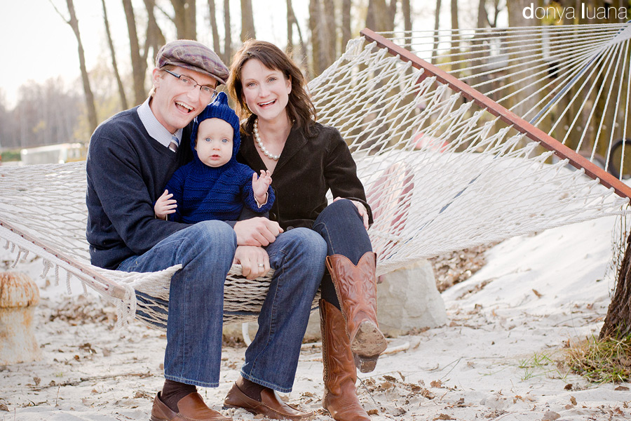 Family poses in hammock for family portraits in Twin Cities Minnesota
