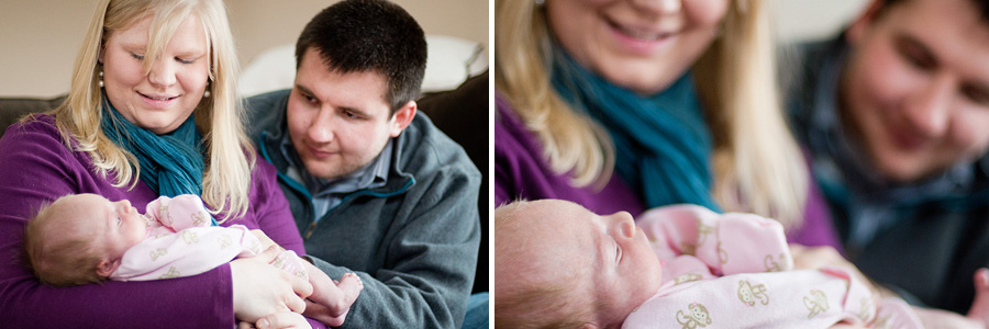Baby girl held in parents' arms at home in Farmginton Minnesota for newborn family portraits