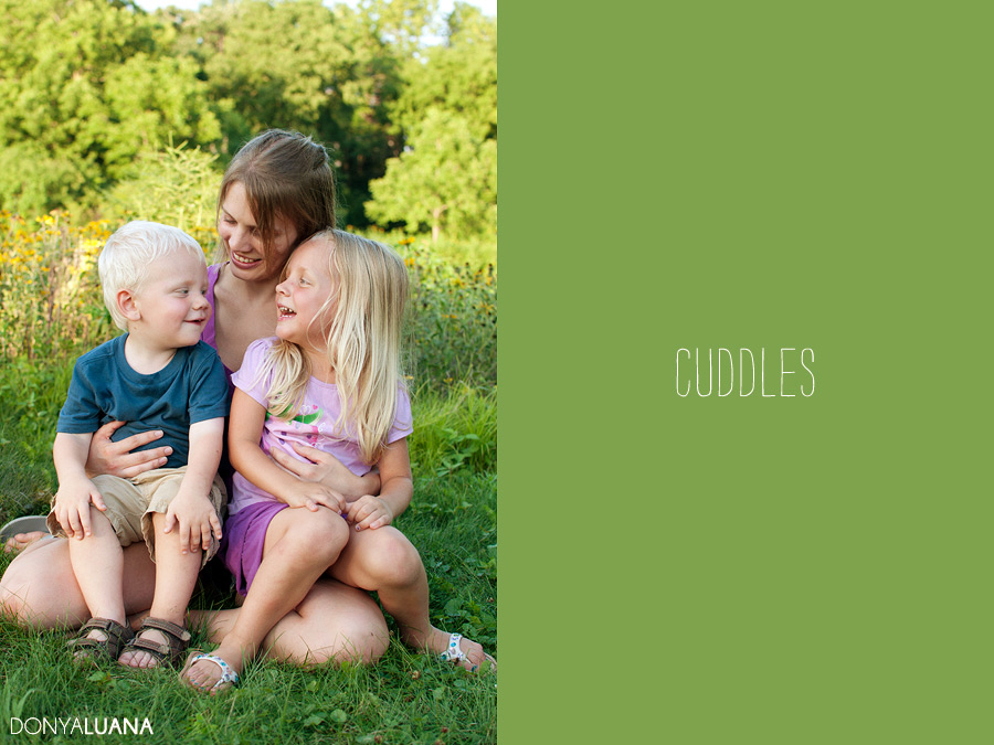 Mother cuddles her children at the Woodlands Texas on a summer evening