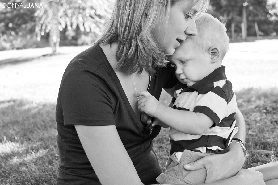 Lifestyle photo of Mom and Toddler Son Pose for Family Portraits