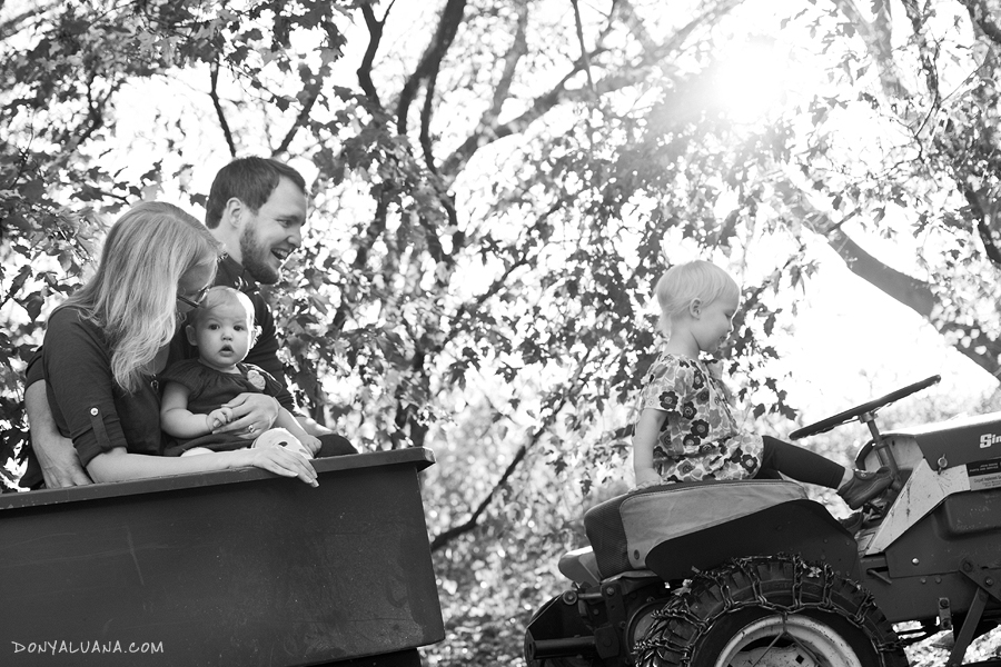 Tomball Family portraits taken in backyard with tractor