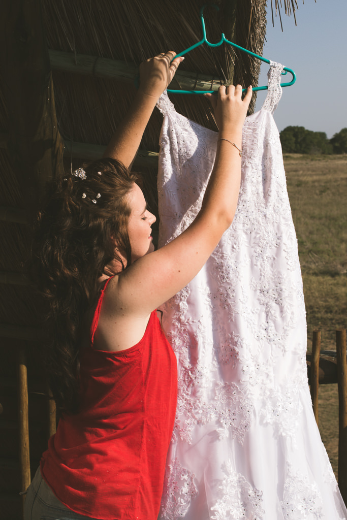 Safari Park Hluhluwe St Lucia RBadal Photography bride reaching for dress