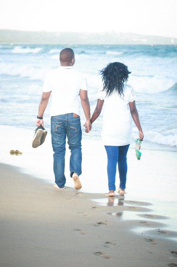 durban photography engagement walking on beach african