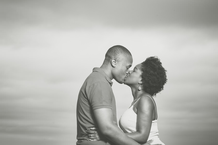couples shoot ballito beach rbadal photography pictures boat house holding each other and kissing