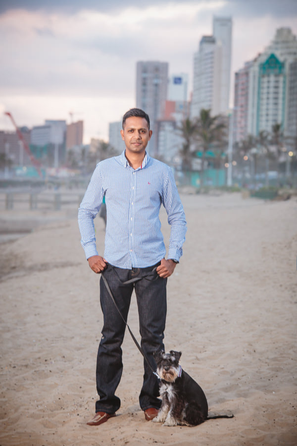ceo portrait shoot durban rbadal photography at beach with dog on leash north beach