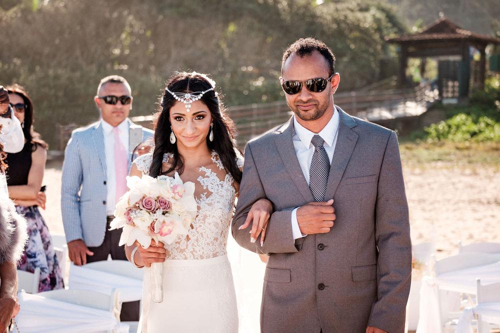 Zimbali Ballito Wedding Photography RBadal beach ceremony bride aisle