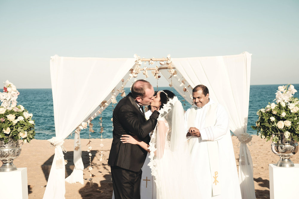 Zimbali Ballito Wedding Photography RBadal beach ceremony first kiss