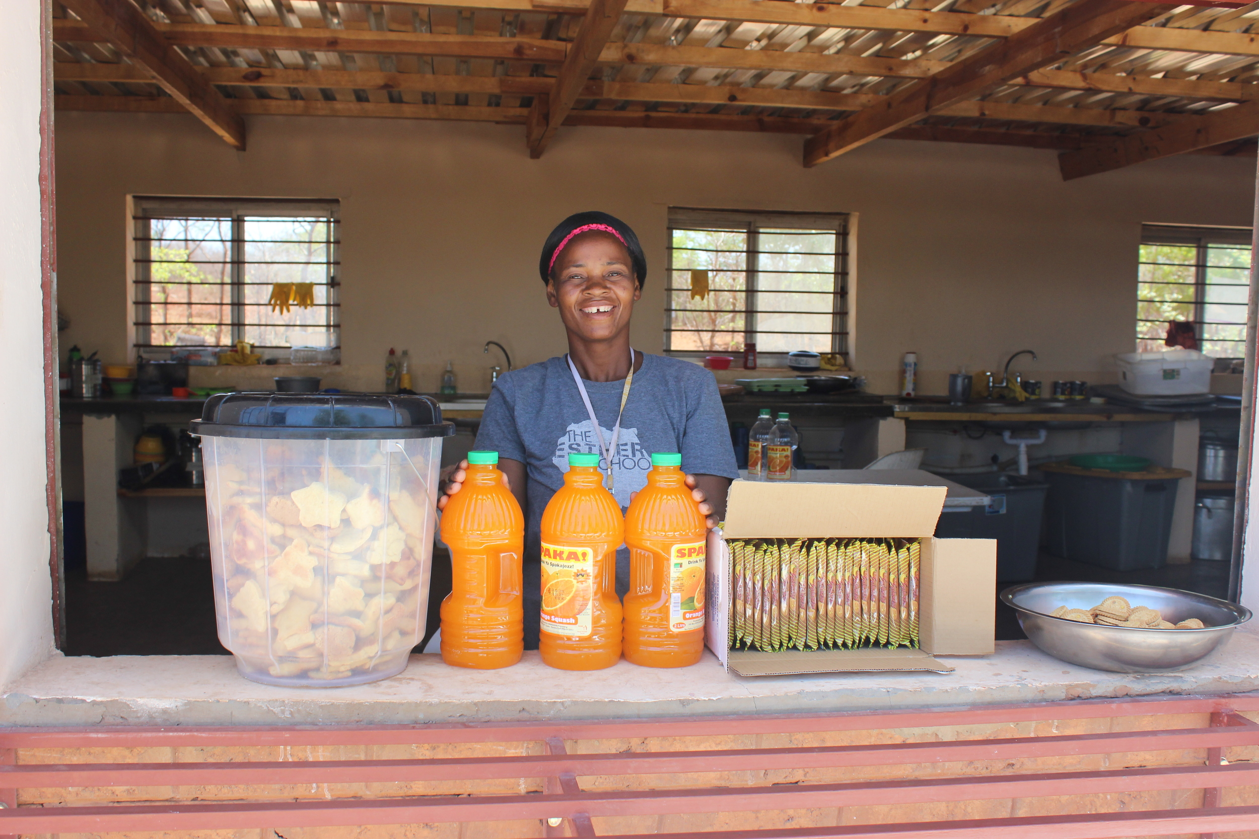 Mama Charity, the head of the kitchen, preparing snack for Family Day