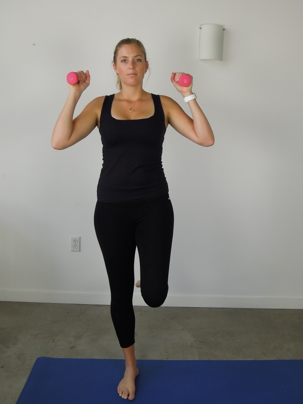 Single leg balance with overhead press Begin by balancing on one leg with weights on top of shoulders. Then raise both arms overhead without losing balance.