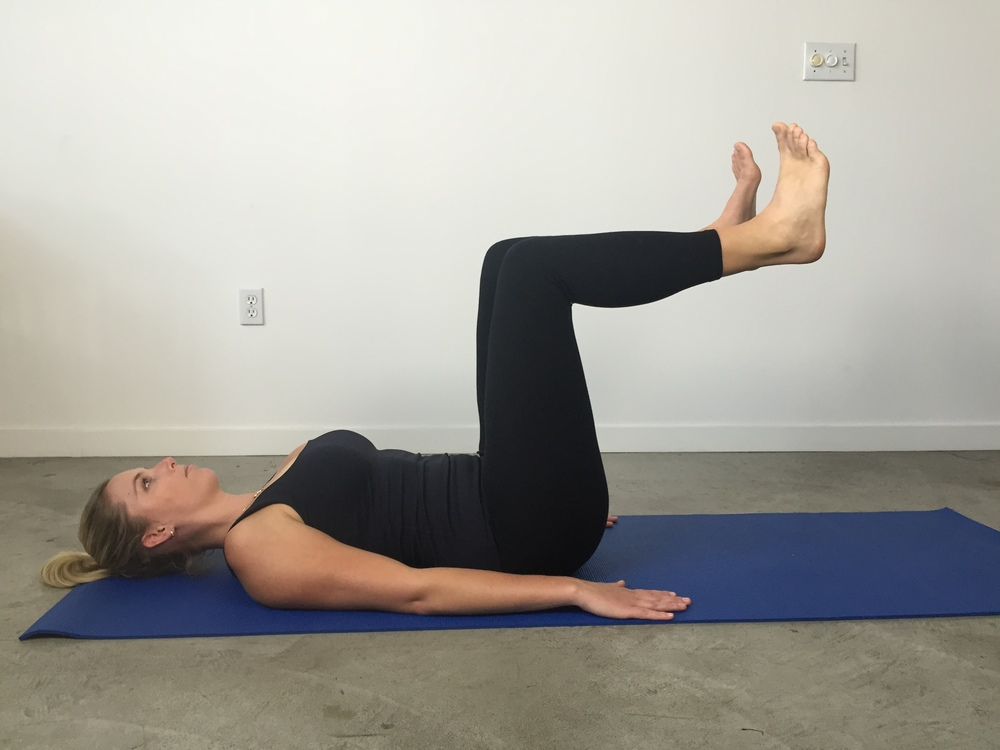 Up up down down:  While holding the first leg in table top position, slowly float the second leg up. The lower one by one back down to the floor. Try not to hold your breath or bear down on your pelvic floor.