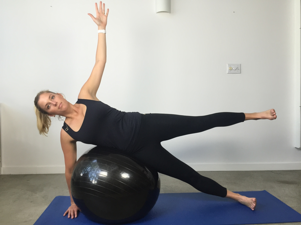Side lying balance over ball with side leg raise  Once you have your balance try to raise the top leg using your bum muscles. Careful not to bring that leg forward or twist your body. You can either raise the leg up and down or pulse at the top of the lift.