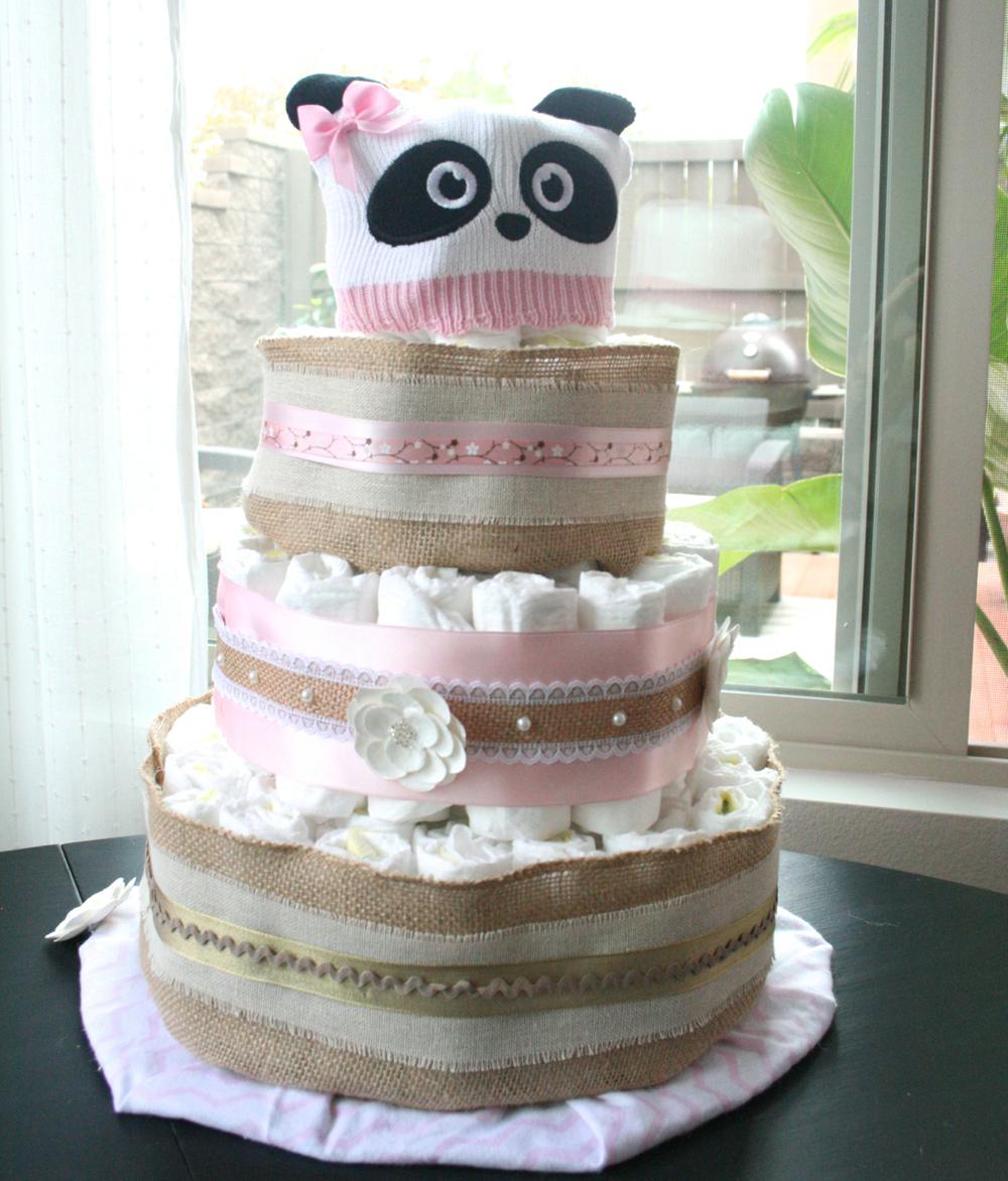 Adorable diaper cake. I love the panda hat!!
