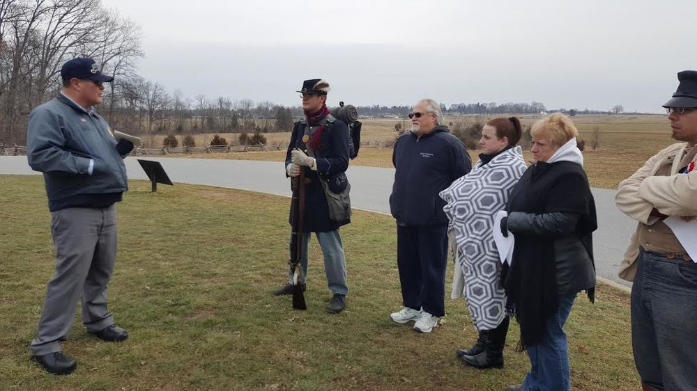 Licensed Battlefield Guide Jim Pangborn takes a group of Reenactors on a tour of Pickett's Charge Saturday morning.  This part of the program was sponsored by the Gettysburg Anniversary Committee.
