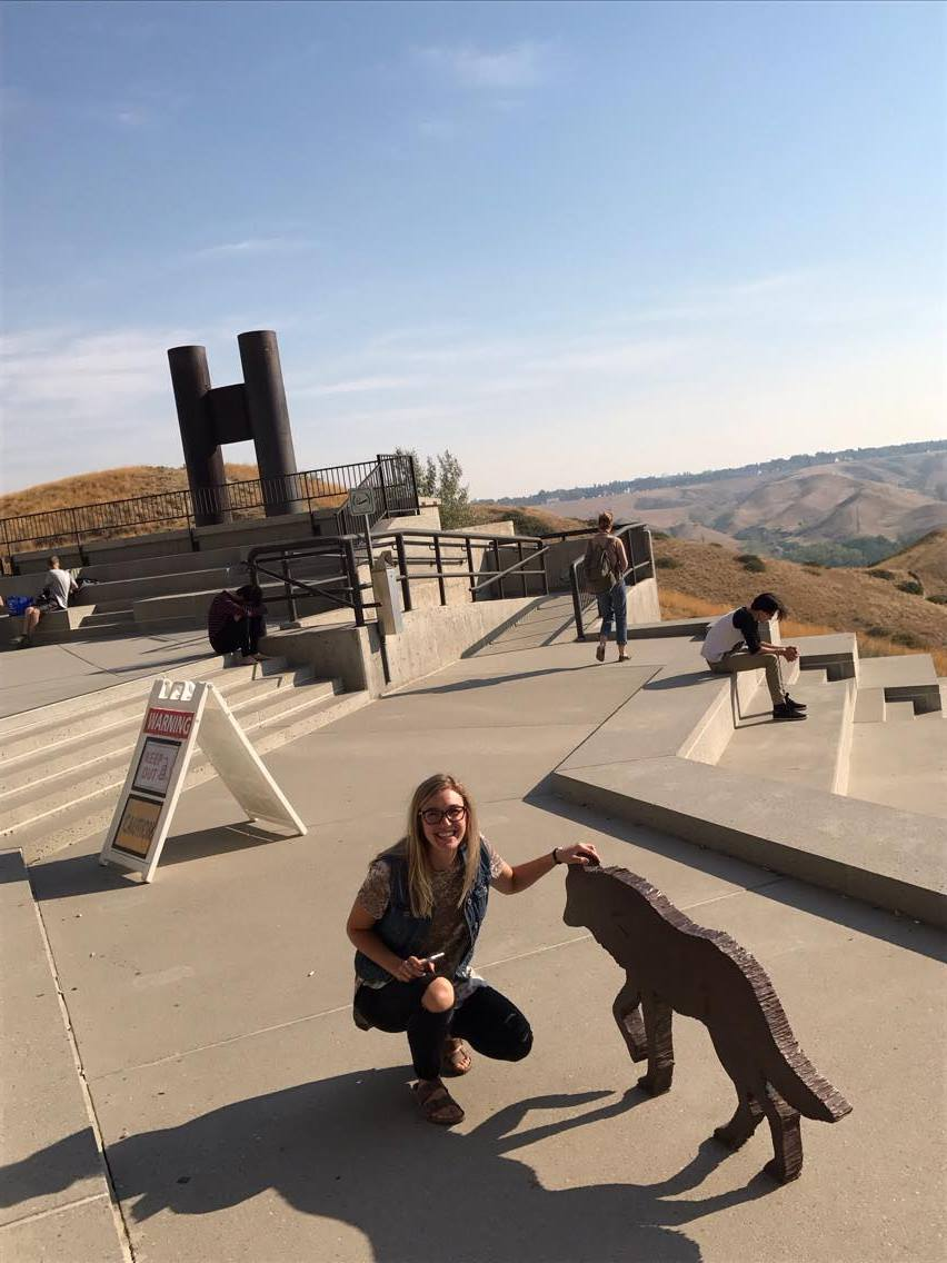 Reanne saying hello to the wolves on the UHall patio near the smoke stacks.