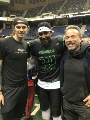 Outstanding Defensive back Maurice Thorne, with Float Zone staff member Grayson on left and co-owner Dr. David Berv on right, after another dominating game at the Richmond Coliseum.