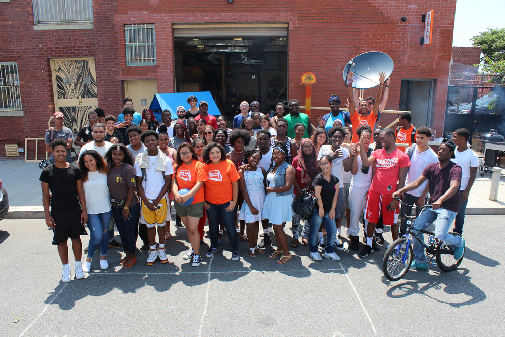 """Big, Bold Beam Apprenticeship - We had our biggest Apprenticeship summer yet working with over 80 teenagers in three locations (one in Brooklyn and two in the Bronx). Two groups created """"Watershed"""" a rolling educational cart with games designed to teach younger children about water ecology, while another group created a """"Solar-powered Satellite Dish"""" that communicated with plants! The Brooklyn teens took the Watershed to several local playgrounds in Red Hook, engaging younger kids in learning about science and the environment.Teens also explored NYC waterways by going canoeing on Newtown Creek and taking a trip to the Rockaways! It was the first time many of the teens either rode a canoe or swam at the New York beach.Posted September 2017"""