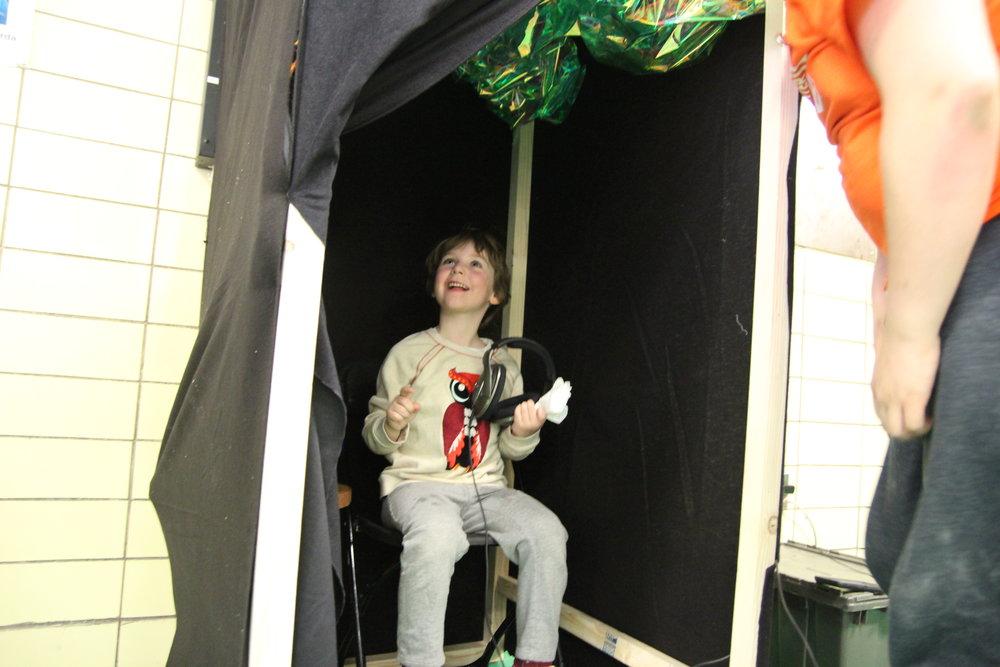 kid in booth.JPG