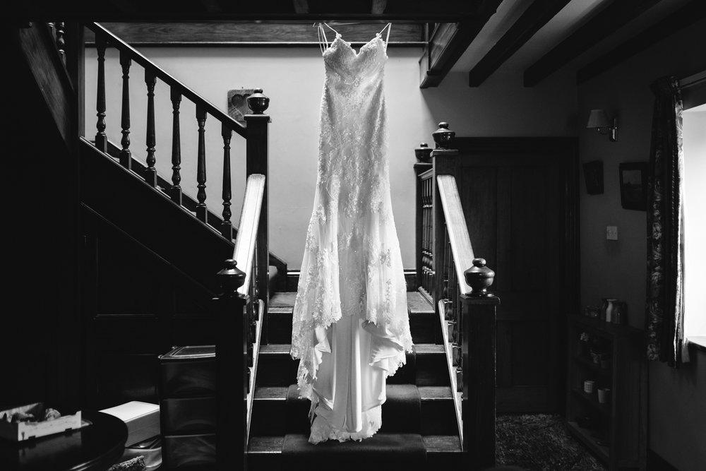 Wedding dress hanging up - Powys Wedding Photography