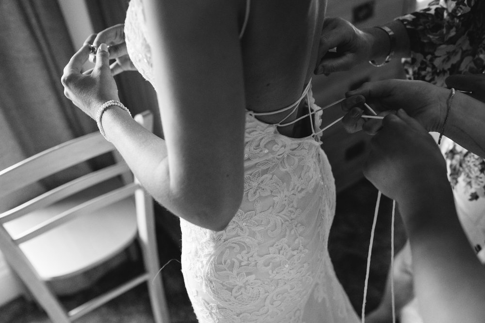 Wedding dress being done up - Powys Wedding Photography