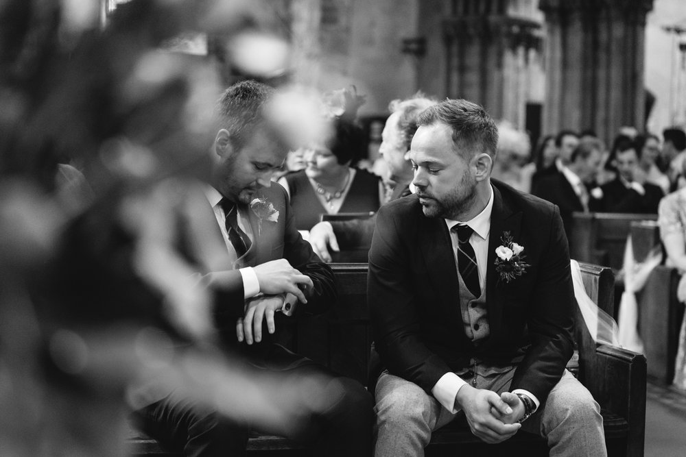 Groom and best man waiting at church - Powys Wedding Photography