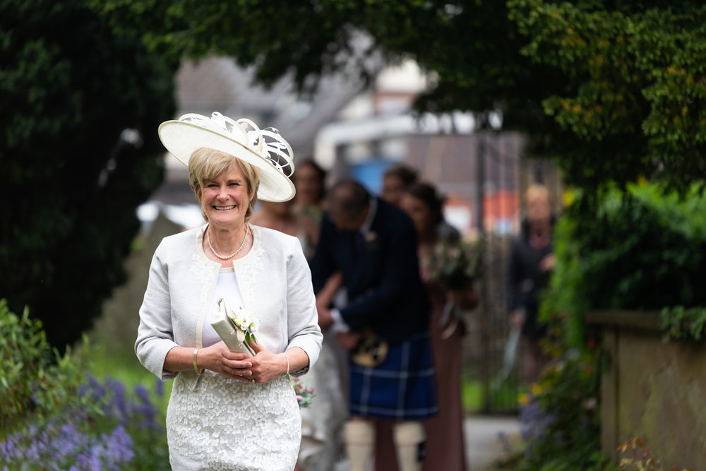 Brides mum arriving at church - Powys Wedding Photography
