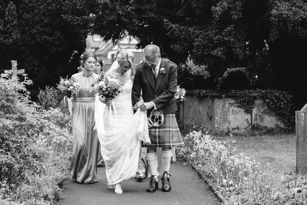 Bride and father walking in to Llanidloes church - Powys Wedding Photography