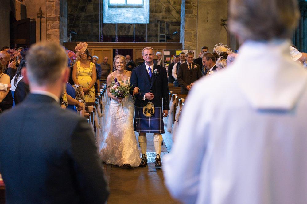 bride walking down aisle Llanidloes church - Powys Wedding Photography