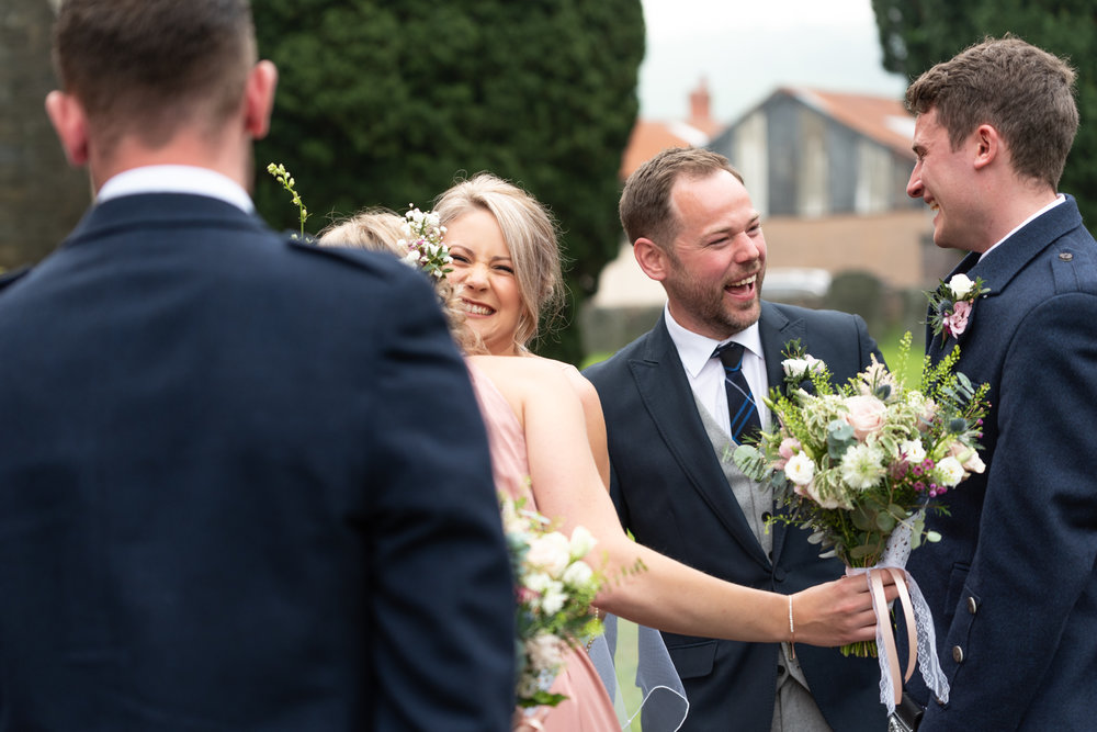 Newly weds greeting guests - Powys Wedding Photography