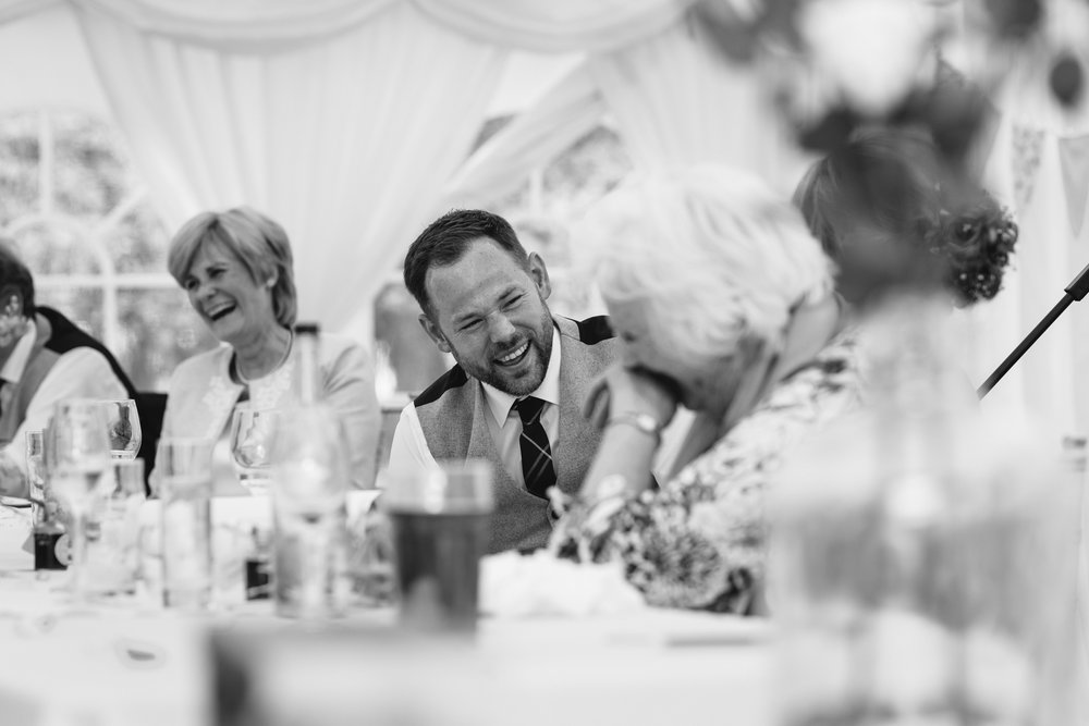Groom laughing - Powys Wedding Photography