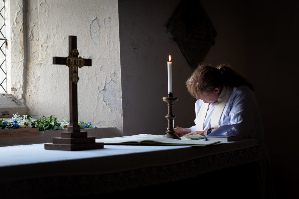 Vicar writing register - Powys Wedding Photography