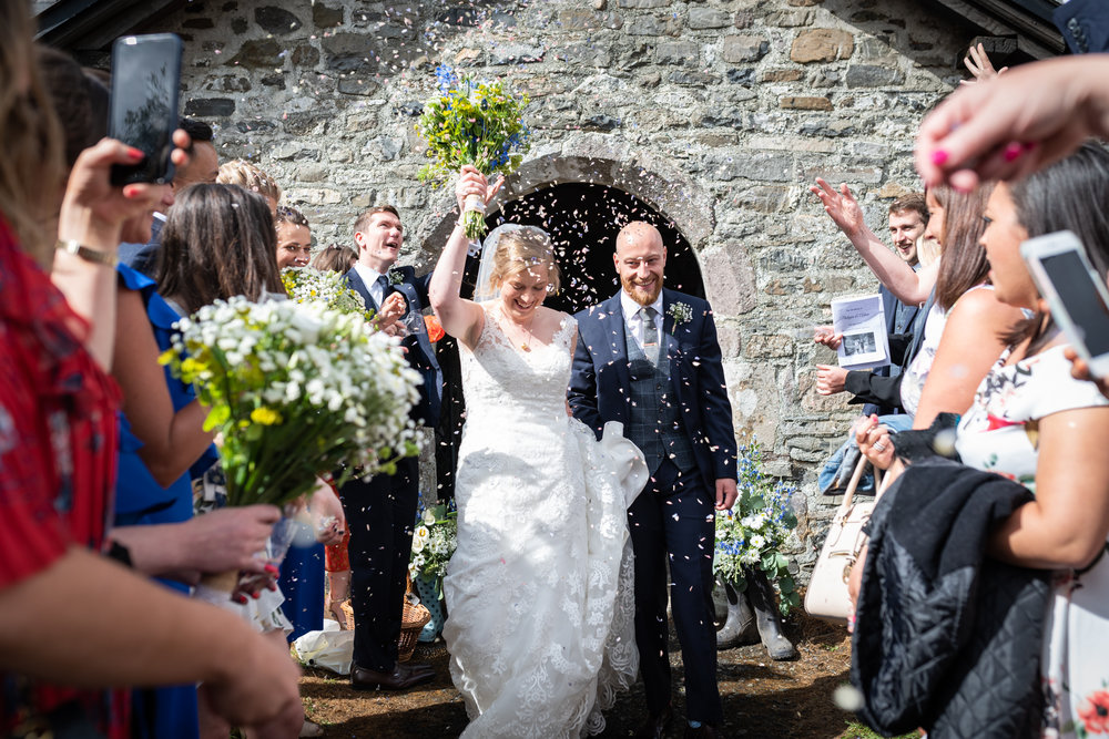 Confetti throwing after wedding - Powys Wedding Photography