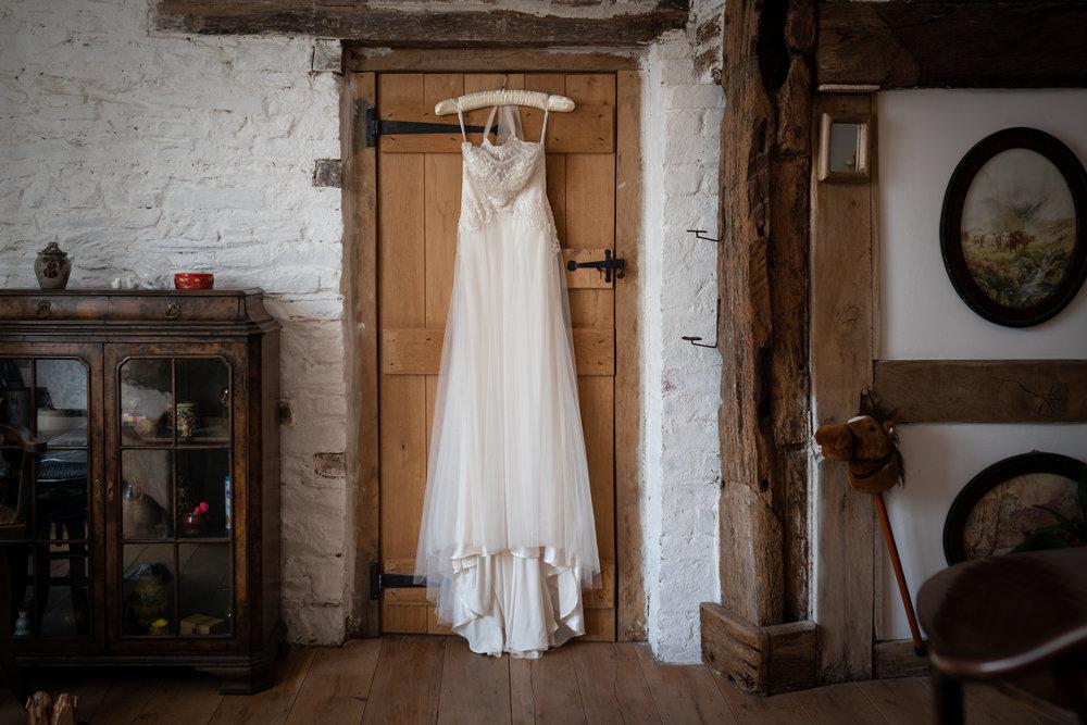 Copy of Wedding Dress Hanging In Doorway