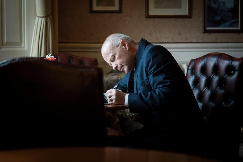 Steven Parry Photography / Dad Writing Speech / Craig Y Nos Castle