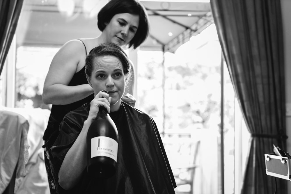 Steven Parry Photography / Bridesmaid Drinking Bottle of Prosecco
