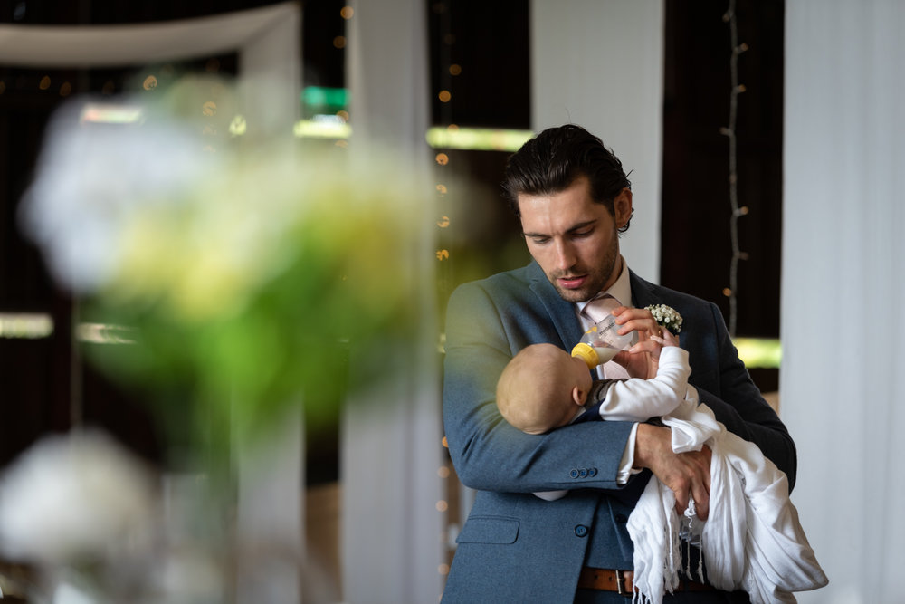 Steven Parry Photography / Groom Feeding Baby Son