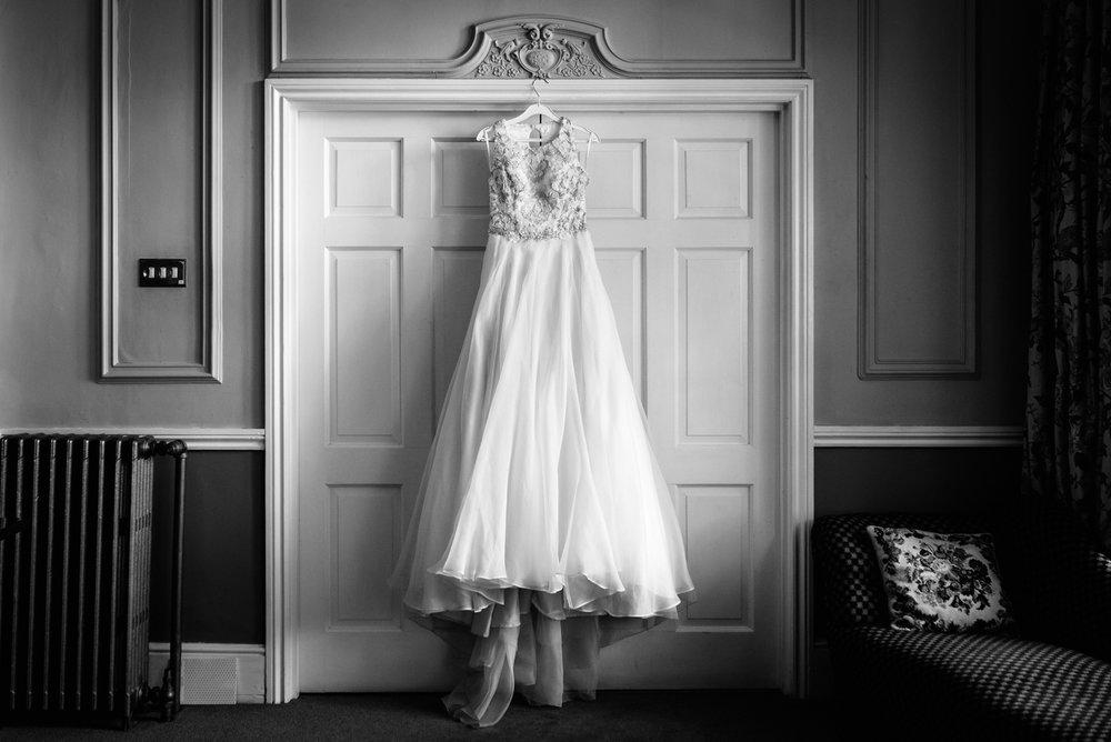 Steven Parry Photography / Wedding Dress Hanging Up