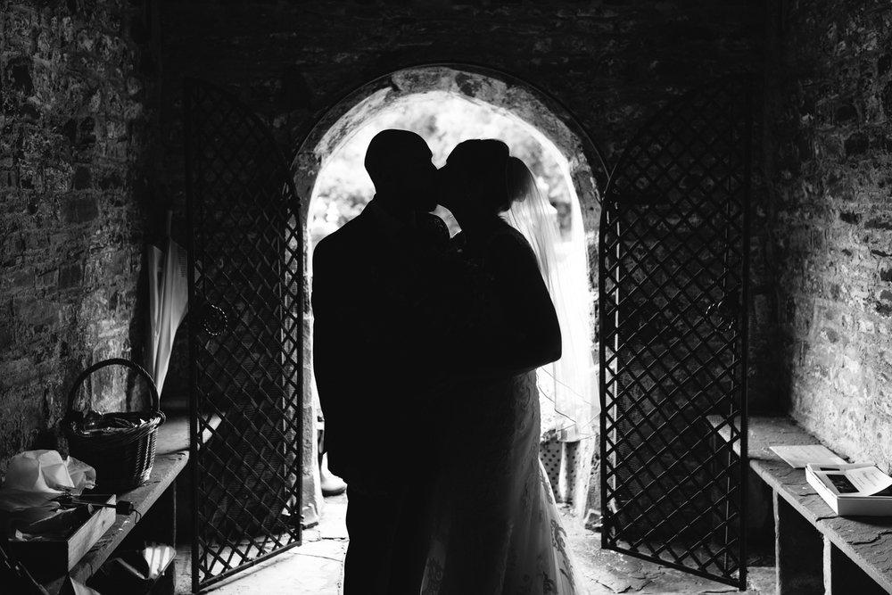 Steven Parry Photography / Bride & Groom Silhouette in Church Doorway