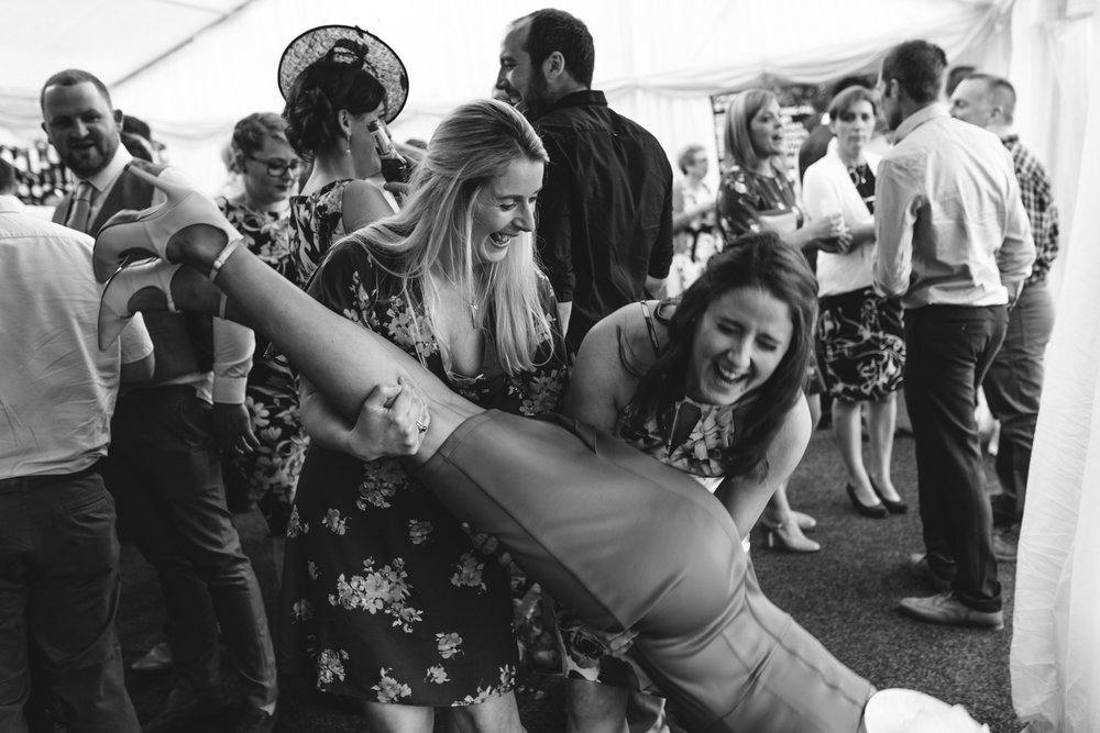 Steven Parry Photography / Wedding Guests Dropping Girl on Floor During Wedding Reception