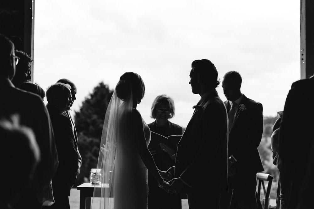 Steven Parry Photography / Bride & Groom During Wedding Ceremony / Sugar Loaf Barn