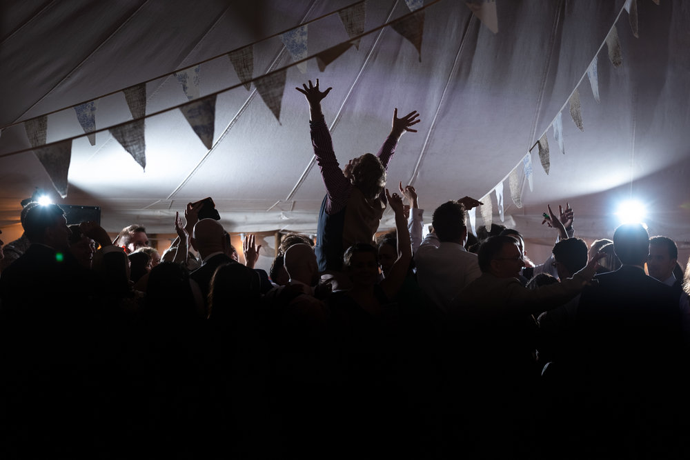 Steven Parry Photography / Wedding Party Guest on Shoulders During Party