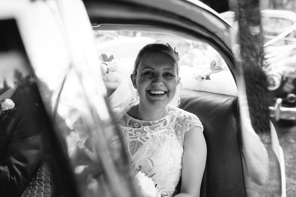 Steven Parry Photography / Bride Arriving at Church in Wedding Car