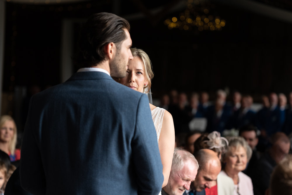 Steven Parry Photography / Bride looking at Groom During Wedding Ceremony / Sugar Loaf Barn