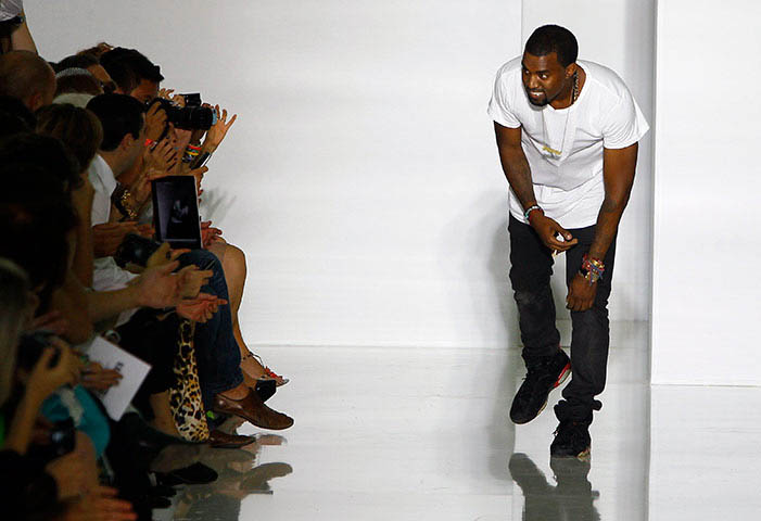 "Kanye West wears ""Black Infrared"" Air Jordan VI's at Paris Fashion Week, 2011."